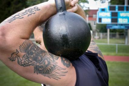 Man Holding Kettlebell